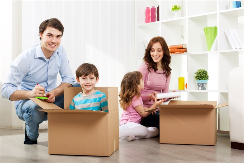 family getting ready to move with kids