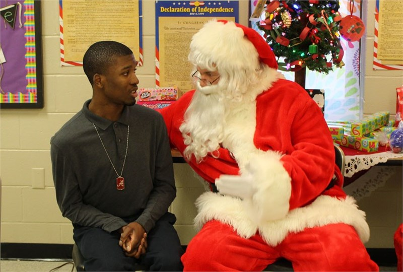 Coleman Senior Vice President Plays Santa for Special Needs Children