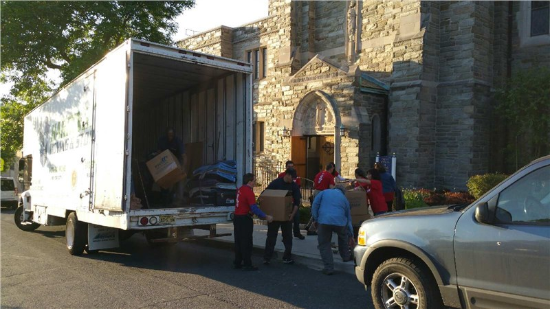 Harrington Helps Delivery Food to Our Lady of Sorrow