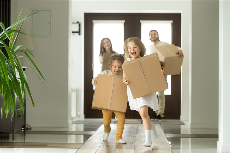 Running kids with boxes
