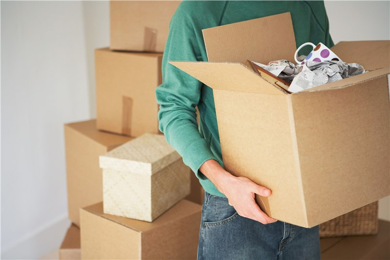 man holding open first moving box