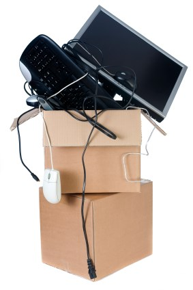 computer equipment overflowing moving box