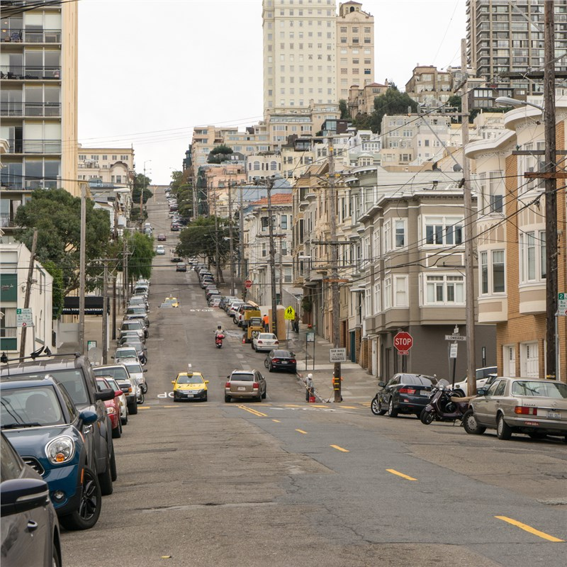 san francisco street lined with cars
