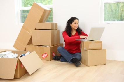 woman packing while on computer